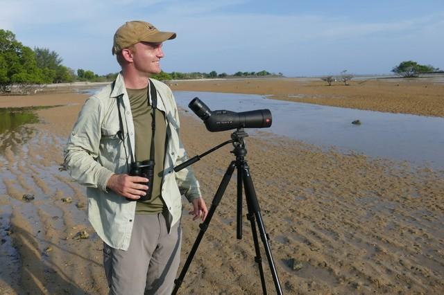 Noah Strycker looking for shorebirds in Bali, Indonesia.
