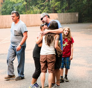 Eric Oftstie reunites with his wife Jenalee, 43; his son Ansel, 10; and their friend Heather Jeppesen.