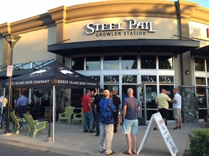 Patrons gather outside the Steel Pail Growler Station in Eugene for the Goose Island migration week event.