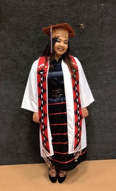 """SuSun Fisher in cap and gown as she graduated from Chemawa Indian School in 2017. The former """"Miss Chemawa"""" is in her first year at University of New Mexico."""
