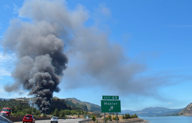 A plume of smoke rises from where a train carrying crude oil derailed in Mosier, near Hood River, on Friday afternoon.