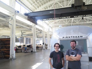"""Andy Baio (left) and Andy McMillan (right) have always been drawn to unfinished spaces, whether it was hosting XOXO fest 2014 in the under-wired Redd building or the airy warehouse they picked for the Outpost. At this point, to work in a completed building, McMillan jokes, """"almost feels like cheating."""""""