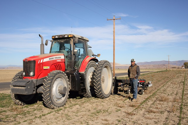 Farmer Phil Fine relies on water out of Wickiup Reservoir to irrigate his fields every summer.