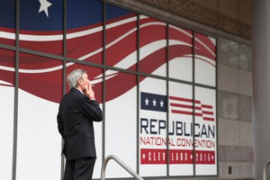 A smoker takes a break outside the 2016 Republican National Convention in Cleveland.