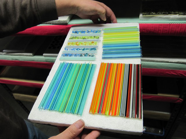 Glass samples show the range of colors Bullseye can produce. Cadmium is used to create yellows.