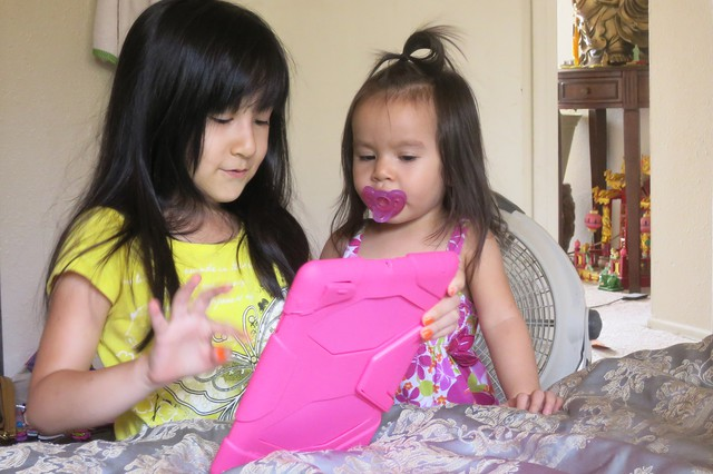 Leyna plays with her little sister.