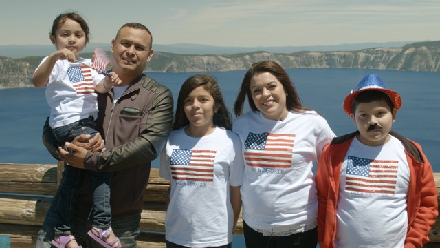 Alma Velazquez celebrates her citizenship with her family after the naturalization ceremony at Crater Lake National Park.