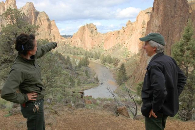 Ranger Josie Barnum and park director Scott Brown survey the valley in Smith Rock State Park. The park already sees crowds of at least 2,000 visitors on a weekend day. During the solar eclipse, there could be double or triple the visitor volume.