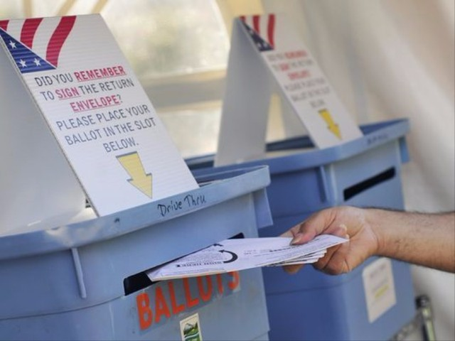 Voters drop off ballots at a drop site outside the Marion County Courthouse in downtown Salem in this undated file photo.