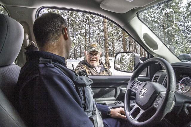 Oregon State Police Trooper Dain Gardner talks to a hunter near Ukiah on Tuesday, Nov. 14, 2017.