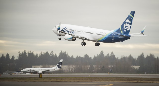 An Alaska Airlines Boeing 737-800 painted with the airline's new tail logo and livery Tuesday, Jan. 26, 2016, at Seattle-Tacoma International Airport in Seattle.
