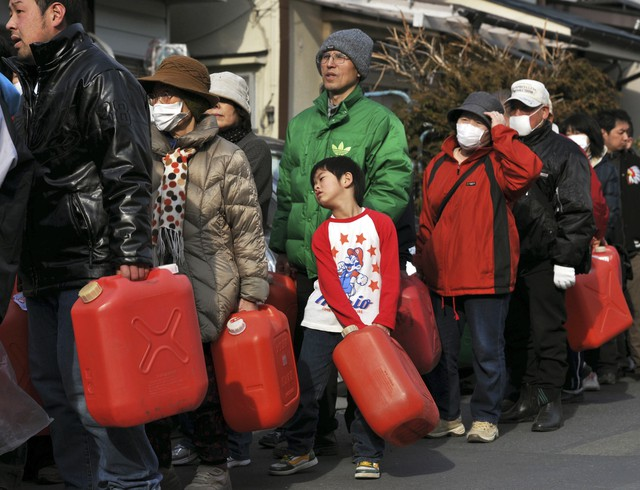 A boy waits in a line in front of a gas station in Kamaishi, northern Japan, March 14, 2011 following a massive earthquake and tsunami.