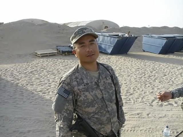 In this undated file photograph courtesy of Chong Kim provided by his attorney Tim Warden-Hertz, Chong Kim poses for a photo in National Guard fatigues. An immigrant rights group is asking the U.S. Department of Homeland Security to release an Iraq War veteran who has been detained for more than three months while waiting to learn whether he'll be deported. Chong Kim, a South Korean immigrant and green card holder from Portland, Oregon, joined the National Guard in 2005 and served in Iraq in 2009 and 2010.