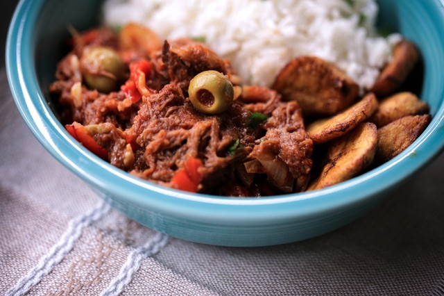 Hearty, deeply flavored Ropa Vieja is served with white rice and fried plantains. To prepare this dish at home, you can cook the flank steak on the stovetop or in a pressure cooker or slow cooker.