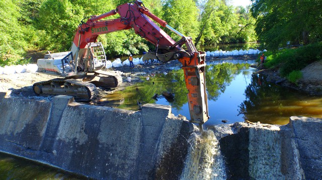 Demolition crews knock out first notch in Wimer Dam on Evans Creek, a tributary of the Rogue River.
