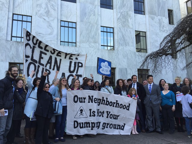 Dozens of Portlanders rally for clean air at the state capitol building after delivering a petition to Gov. Kate Brown.