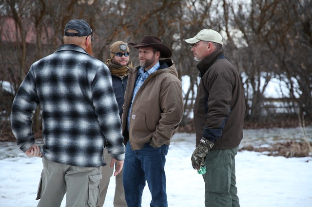 Ammon Bundy meets with occupiers after a Saturday evening press conference.