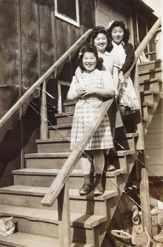 Taka Iwasaki, Noriko Kido, and Aya Iwasaki at the Adrian farm labor camp, circa 1943.