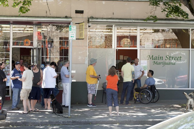 Line outside of Main Street Marijuana, in Washington, on July 9, 2014, when retail recreational marijuana became legal in the state.