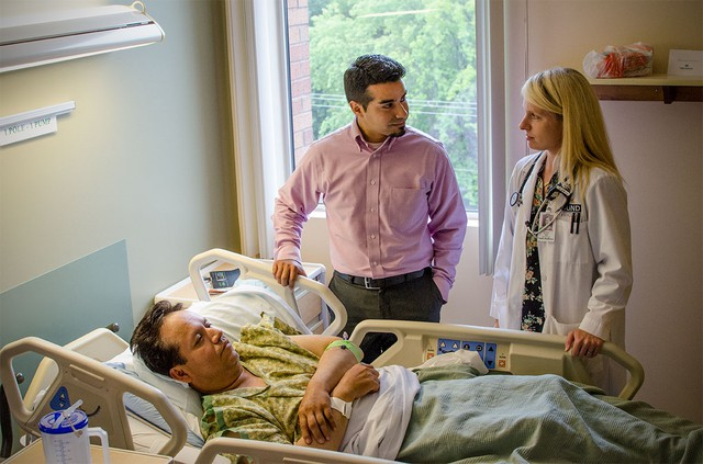 """Dr. Angela Alday communicates with her patient, Isidro Hernndes, through Spanish interpreter Armando Jimenez."""
