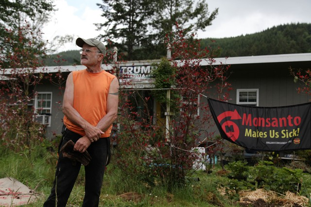 Harry Hoffman stands outside his house on Oregon Route 38.