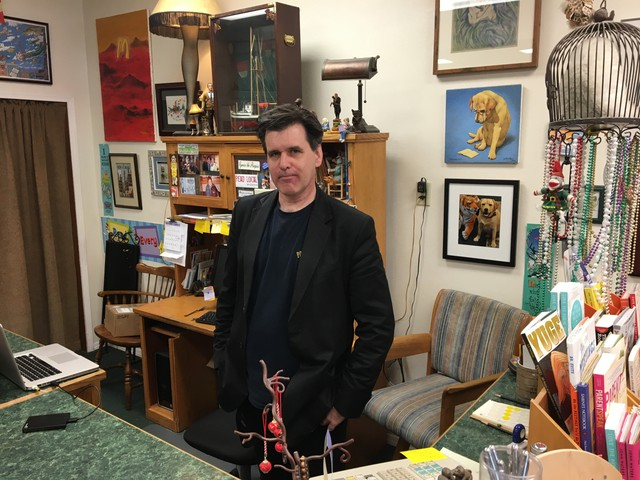Bill Ham is a local actor in Ilwako, Washington, pictured here at his job at Time Enough Books.