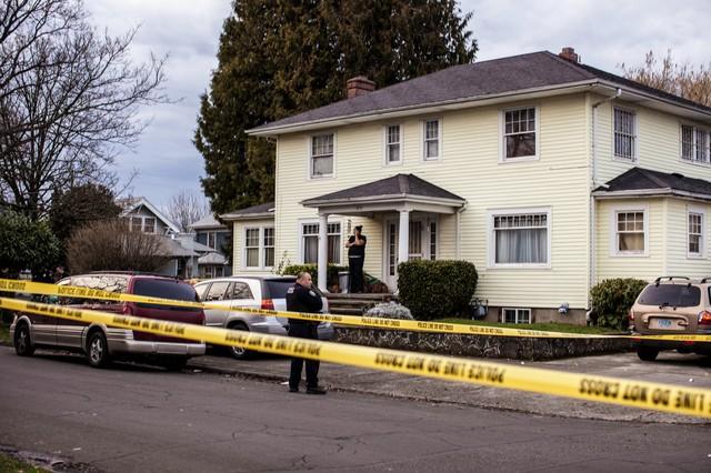 Police tape circles a crime scene in NE Portland.