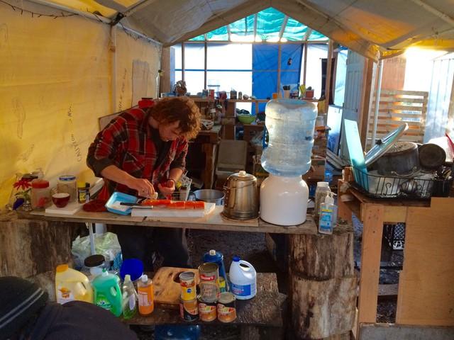 Bob Brimmer prepares a salmon dinner for Hazelnut Grove residents.