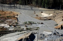 """Officials described the mudslide as """"a big wall of mud and debris."""" It blocked about a mile of State Route 530 near the town of Oso, about 55 miles north of Seattle."""