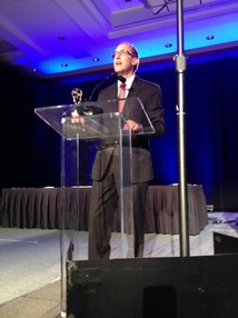Steve Bass accepts the 2014 Northwest Regional Emmy for Station Excellence.