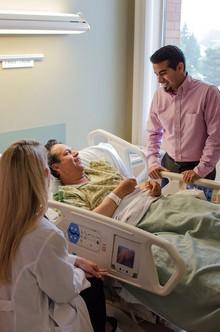 Dr. Angela Alday confers with her patient, Isidro Hernandes, through interpreter Armand Jimenez.