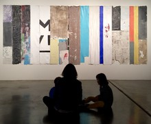 A mother and her children look at Pablo Rasgado's work at the Disjecta Contemporary Art Center.