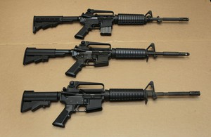 In this Aug. 15, 2012 file photo, three variations of the AR-15 assault rifle are displayed at the California Department of Justice in Sacramento, Calif.
