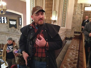 Jason McMillan carrying a military-style pistol in the Washington House gallery in 2015. Beginning in January 2018, guns will be banned from the Senate gallery.