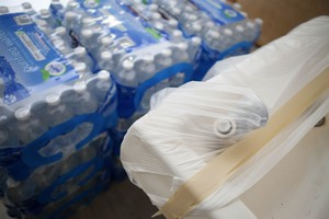 A covered drinking fountain sits next to cases of bottled water at Llewellyn Elementary in Sellwood, in Southeast Portland.