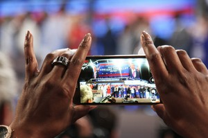 A delegate takes a photo at the Democratic National Convention in Philadelphia.