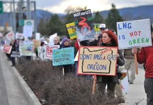 In this January 2016 photo, people protest on Crater Lake Highway against the LNG Pipeline. The Ramada hotel has canceled reservations for dueling meetings the two sides had planned on the same night in Medford.