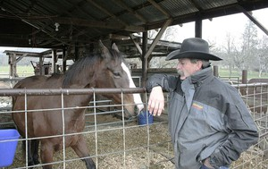 Rancher Lee Bradshaw visits a horse on his property near Eagle Point, Oregon. The near-doubling of the Cascade-Siskiyou National Monument poses challenges for people like Bradshaw, who has a cattle grazing allotment within the expansion.