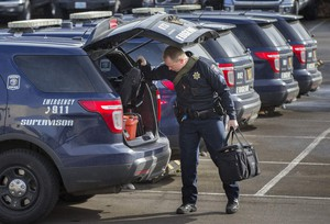Eugene police Sgt. Ryan Molony loads his patrol car for a patrol shift. In 2017, Eugene police or 911 dispatch supervisors disregarded about one-third of daily average calls that the department received.