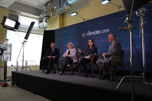 Oregon Gov. Kate Brown, second from right, and Washington Gov. Jay Inslee, left, are joining together in support of clean energy.