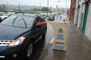 A voter deposits a ballot into a Multnomah County drop box in this 2008 file photo. The county's voters will decide this election whether or not to keep electing sheriffs after a string of scandals have rocked the Multnomah County Sheriff's Office.