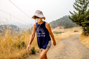 Lisa Bedortha hikes up Mount Pisgah outside Eugene wearing a dust mask.
