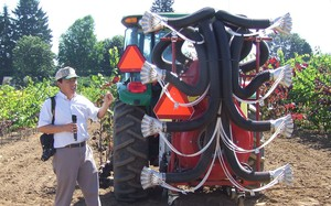 Heping Zhu, agricultural engineer for theU.S. Department of Agriculture, explains the computer system inside a smart pesticide sprayer.