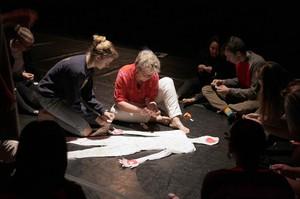 Rachel Harry (center) works with Sara Zeman (left) on a final performance art project at Hood River Valley High School.