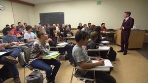 Professor Ben Sanders teaching Comic & Cartoon Studies to a packed classroom
