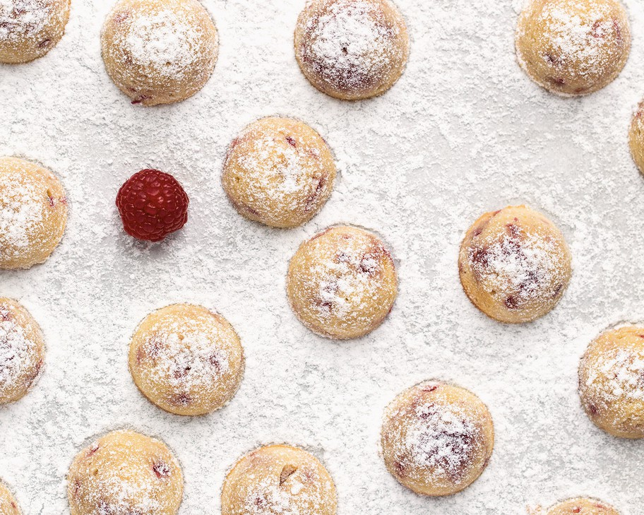"These Raspberry Almond Tea Cakes from ""Modern French Pastry"" are ""easy"" (earning only one-half macaron out of three) and can be filled with frozen berries out of season."