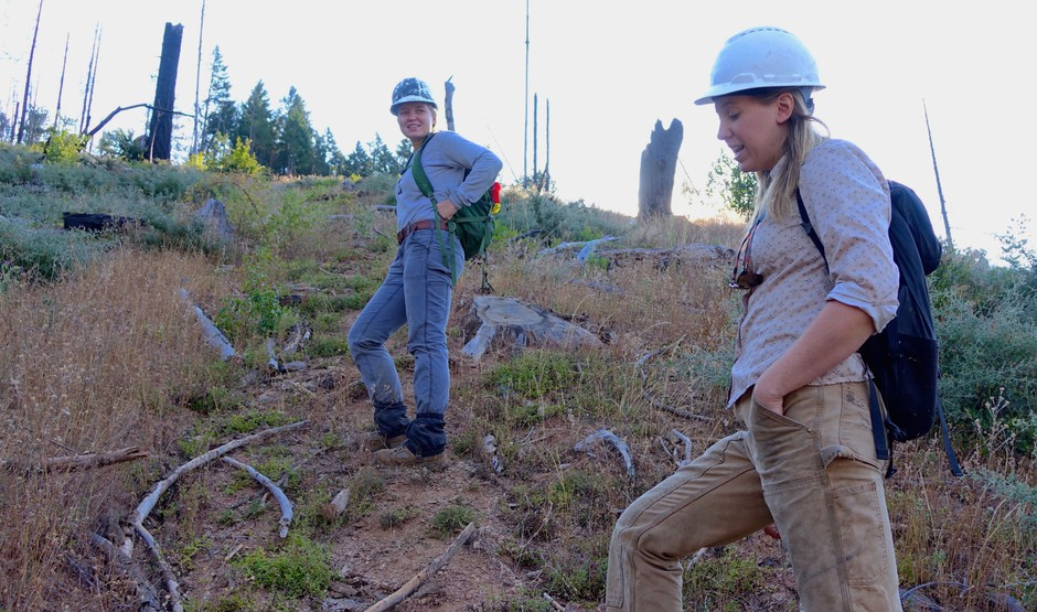 Sydney Watkins (left) and Sara Galbraith hike up a steep slope was that severely burned in 2013.
