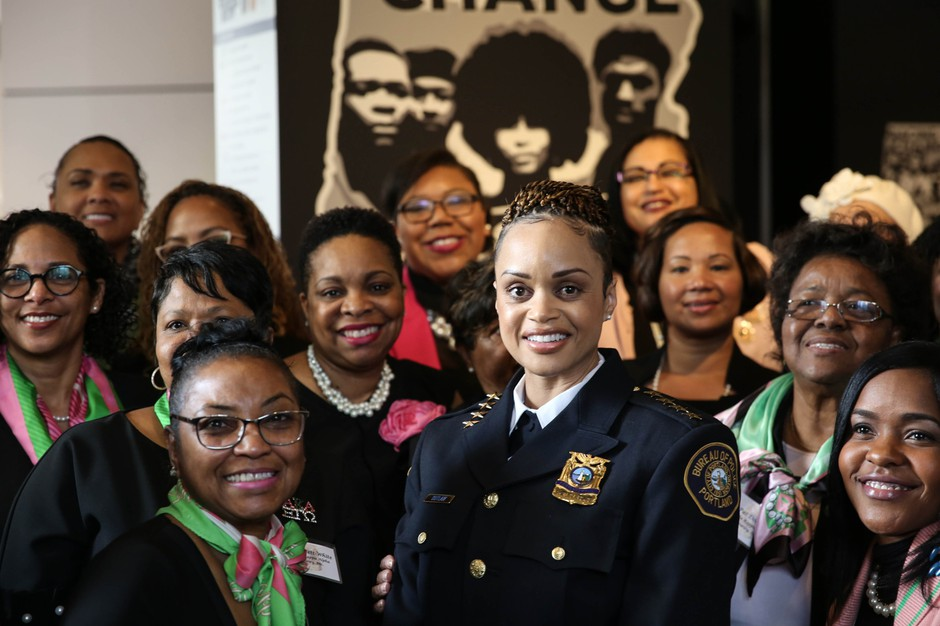 Portland Police Chief Danielle Outlaw poses with sorority sisters from Alpha Kappa Alpha, who filled several rows at her swearing in at the Oregon Historical Society.