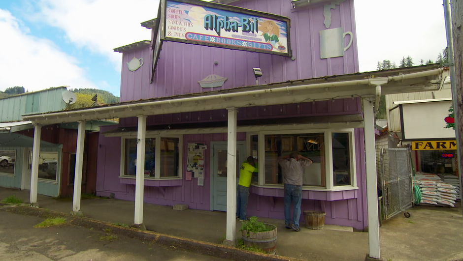 Locals Wade Williams and Dennis Howell peek inside the now-vacant Alpha-bit Cafe
